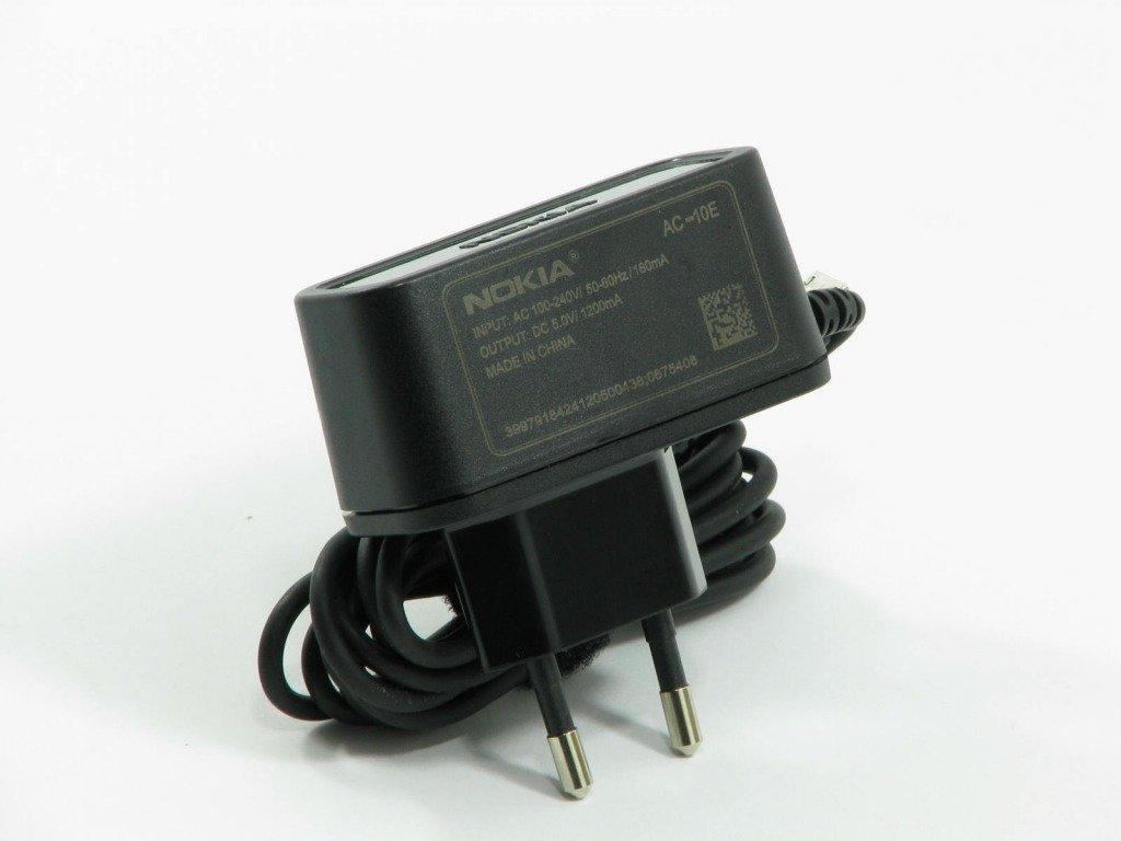 Высокоэффективное зарядное устройство Nokia AC-10 представляет собой экологически безопасное энергос.